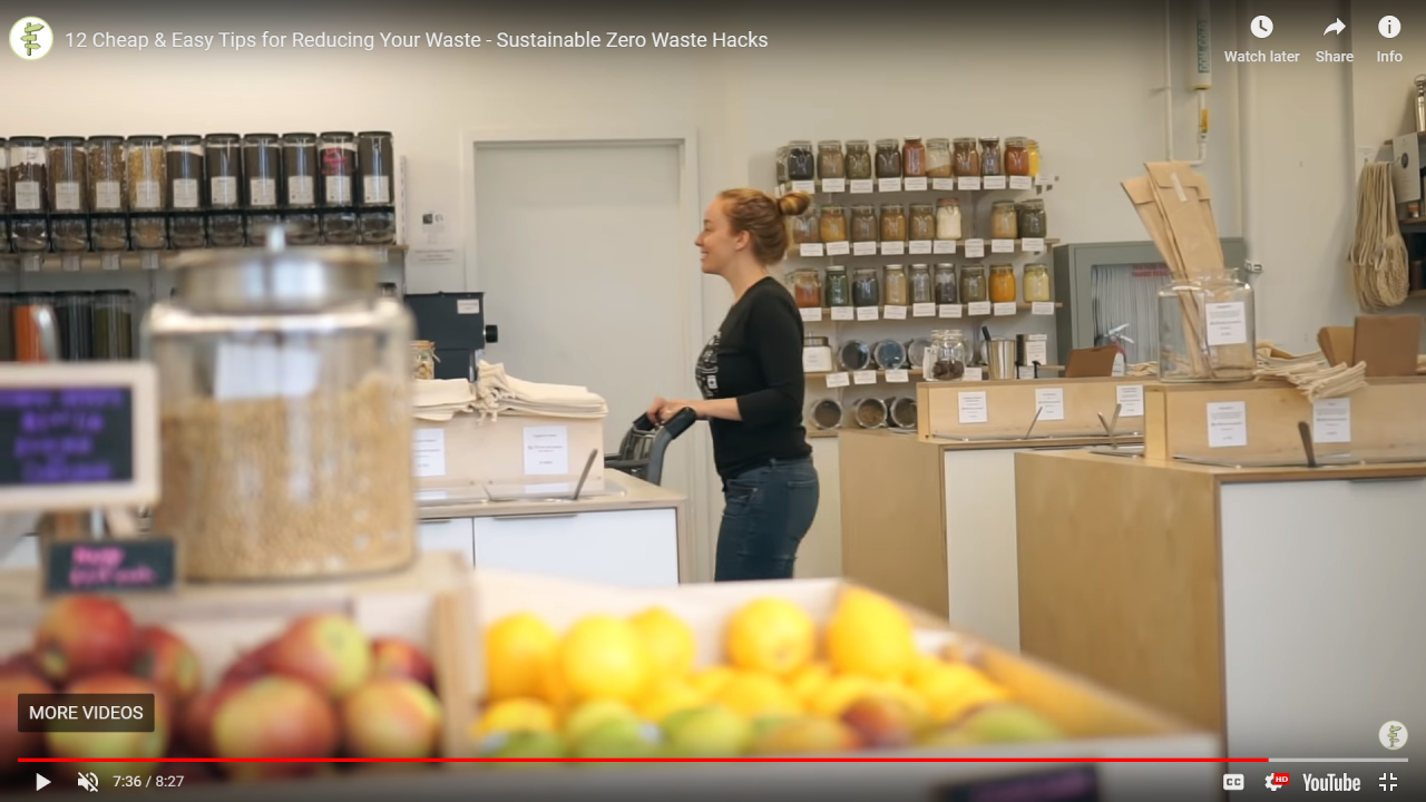 Woman is grocery shopping at a zero-waste grocery store.